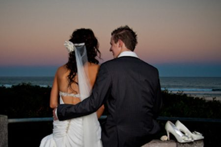 Photo of bride and groom watching sunset by Action Pictures