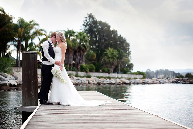 Bride and groom on the wharft at the Coachhouse Marina Resort in Batemans Bay NSW South Coast