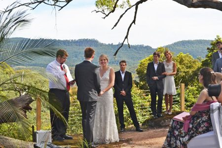 Country wedding ceremony with mountain backdrop at Wildwood in the Kangaroo Valley.