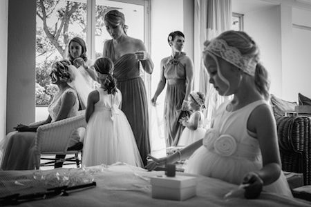 Black and white wedding photo of bride with bridesmaids and flowergirls getting ready for the wedding. Wedding photography by Paul Pennell Photography.