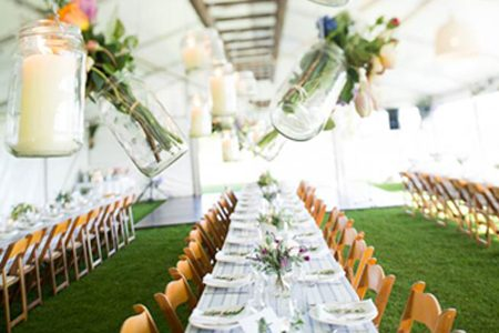 Wedding reception marquee set up with table setting and decorations by Shoalhaven Party Hire