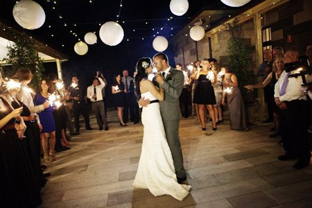 Bride and Groom dancing under lanterns by Special Event Planners
