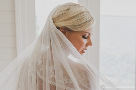 Bride with veil and hair and makeup by Deahne.