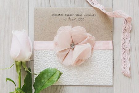 Handmade wedding invtations by Pinnacle Stationery.