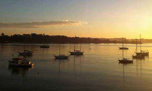 Sunset and boats on the water at Batemans Bay.