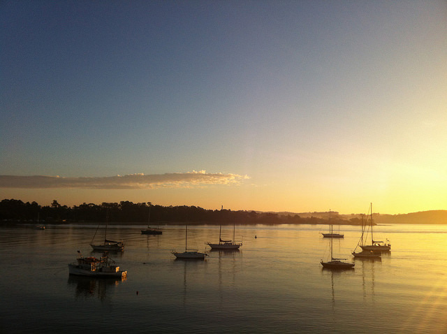 Photo of sunset with boats at Batemans Bay NSW. Photography by Jenny Brown - Flickr