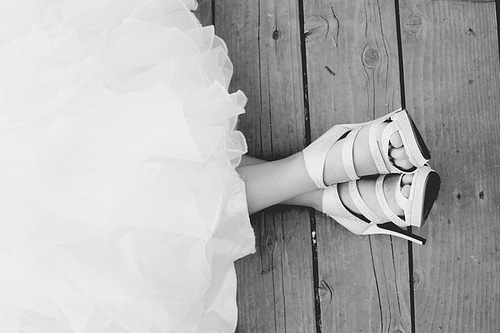 Bride in bridal shoes with beautiful feet