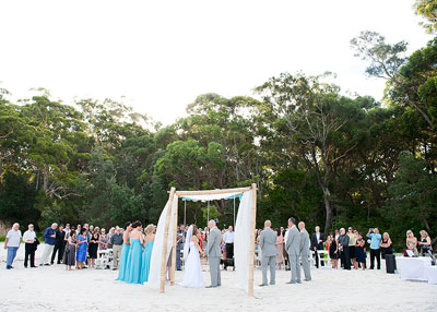 Wedding ceremony at Blenheim Beach, Jervis Bay. Wedding photography by Nora Devai.
