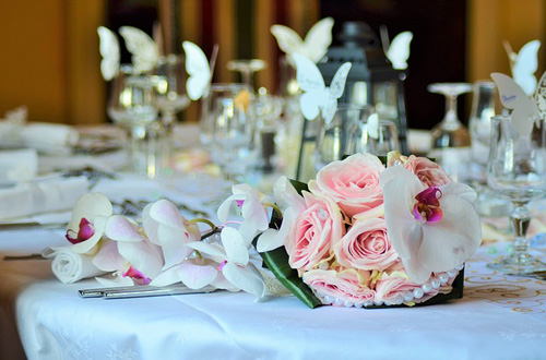 Butterfly wedding theme styled wedding reception table settings.