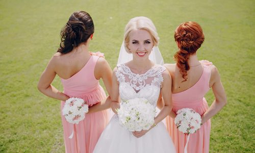 Bride with her two bridesmaids. Things to consider when choosing bridesmaids.