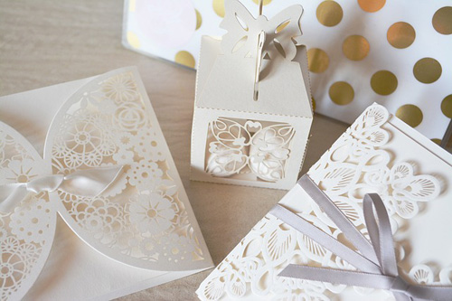 Wedding Stationery with intricate laser cut pattern and ribbon.
