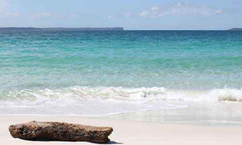 White sandy beach and clear turquoise water of Jervis Bay.